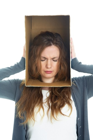 conceptual portrait of a woman's head hidden in a cardboard box photo