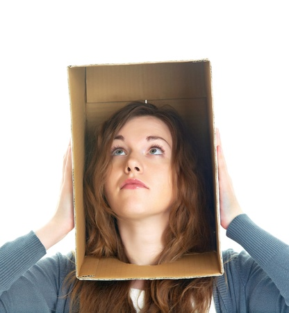 phobia: conceptual portrait of a womans head hidden in a cardboard box