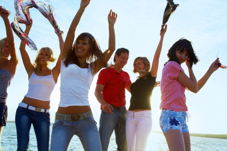 six girls:  happy young teens dancing at the beach on  beautiful summer sunset