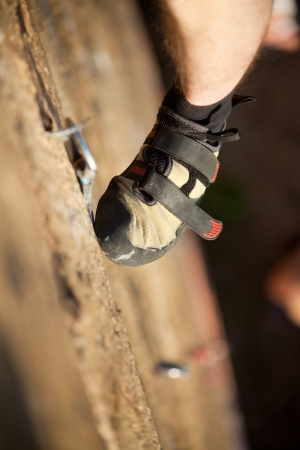 Rock climber's foot on rock Stock Photo - 14386534