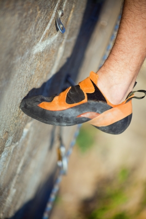 Rock climber's foot on track photo