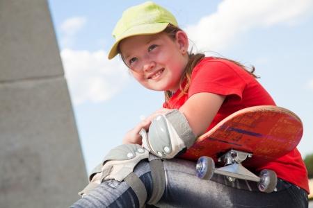 skate board: portrait of little sweet girl with  skateboard