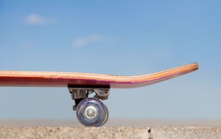 skate board: close the skateboard against the blue sky.