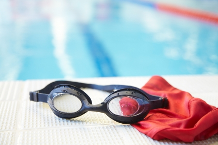 swim goggles: Image of swimming pool, goggles and swimming hat  Nobody Stock Photo