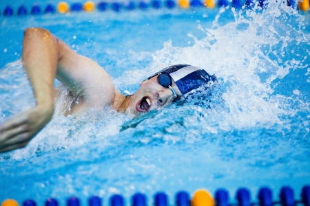 competitive: male professional competitive swimmer in swimming pool Stock Photo