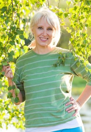 senescence: Portrait of positivity senior woman in summer park