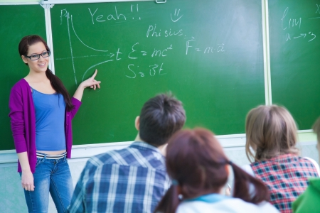 conducts: young woman-teacher conducts lessons with a group of students Stock Photo