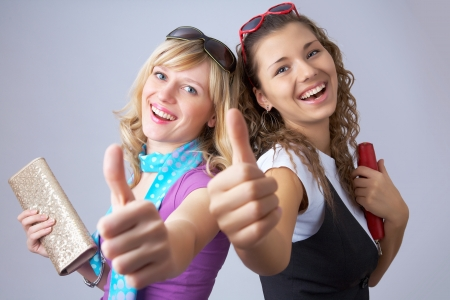 two girlfriends having fun show gesture ok photo