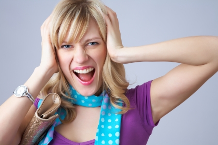 sobbing: Portrait of an excited young woman against white background Stock Photo