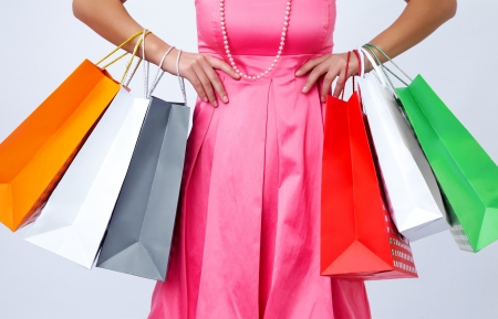 close-up of shopping bags in their hands stylish women. unrecognizable photo