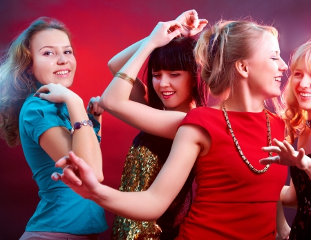 Young beautiful cheerful girls dancing at  party photo