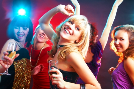 clandestine: Young beautiful cheerful girls dancing at  party Stock Photo