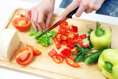 lifestyle home: Human hands  cooking vegetables salad in kitchen