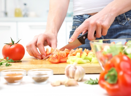 woman knife: Human hands  cooking vegetables salad in kitchen