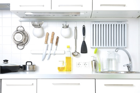 Modern kitchen at home with kitchenware photo