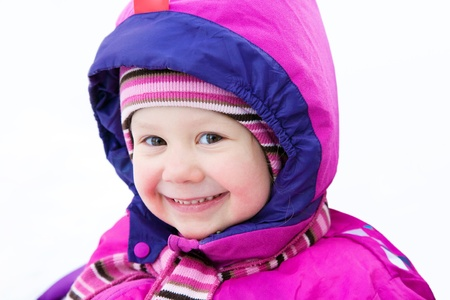 Portrait of cute little girl in winter time photo