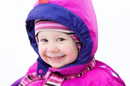 warm jacket: Portrait of cute little girl in winter time Stock Photo