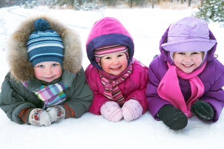 snow woman: Group of children playing on snow in winter time Stock Photo