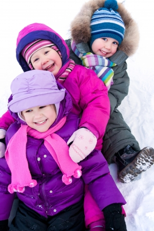 children playing together: Group of children having fun in winter time Stock Photo