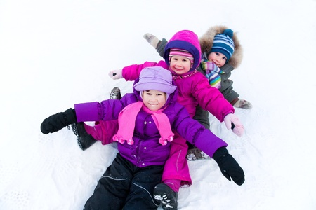 winter sports: Group of children having fun in winter time Stock Photo
