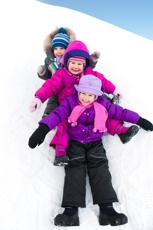 having fun in winter time: Group of children having fun in winter time Stock Photo