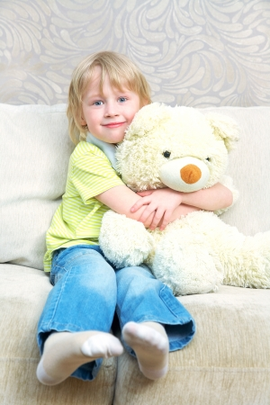 one family: Portrait of little boy with teddy bear at home