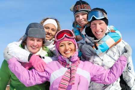 skiers: Portrait of Group of  teenagers have a good time in winter
