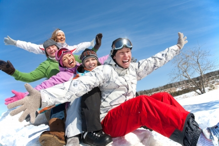 Group of  teenagers slide downhill in wintertime Stock Photo - 15871545