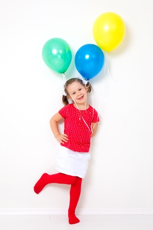 elementary age girl: Portrait of cute little girl with bunch of balloons Stock Photo