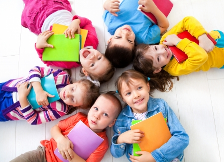 elementary students: Group of children enjoying reading together