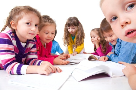 kids learning: Group of children enjoying reading together