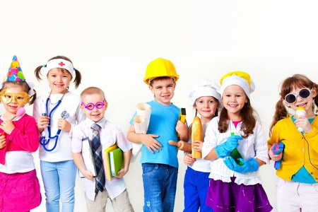 business costume: Group of seven children dressing up as professions