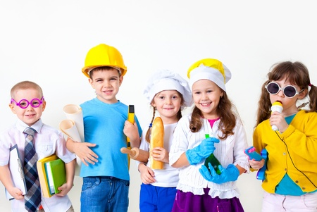 dressing up: Group of five children dressing up as professions