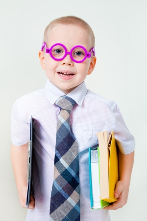 business costume: young boy dreams of becoming a businessman