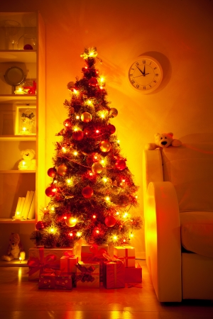 A lighted Christmas tree with presents underneath in living room Stock Photo - 16068756