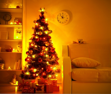 christmas toy: A lighted Christmas tree with presents underneath in living room