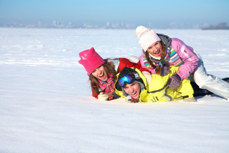 group of young friends tumbles in the snow on a winter vacation Stock Photo - 16035991