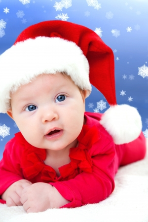fairy-tale portrait of Christmas baby on winter background photo