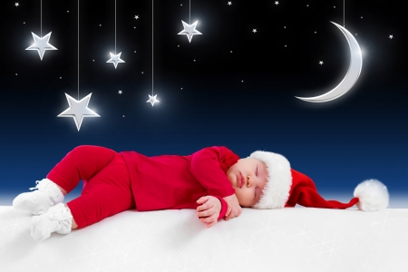 xmas baby: Christmas baby is sleeping on background fairy-tale night
