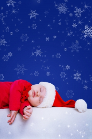 fairy-tale portrait of Christmas baby is sleeping on winter background photo