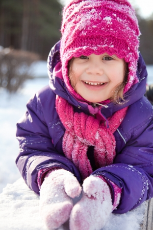 white coats: Portrait of cute little girl in winter