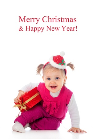 Portrait of little cute child in Christmas hat with gift Stock Photo - 16250045
