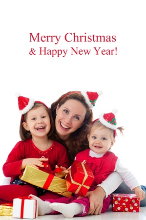 santa girl: Portrait of happy mother with two cute daughter in Christmas hat  Stock Photo