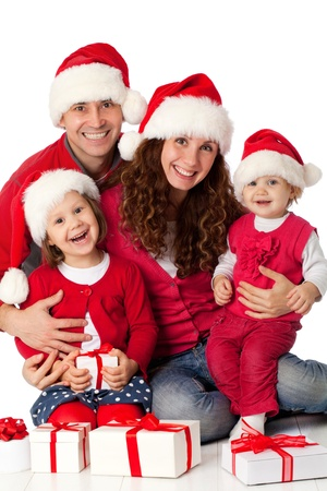 Portrait of happy family in Christmas hat on white background photo