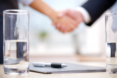 business relationship: Clouse-up of businessman and  businesswoman shaking hands