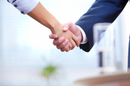 People at work  man and woman hand shaking at a meeting Stock Photo - 16432846