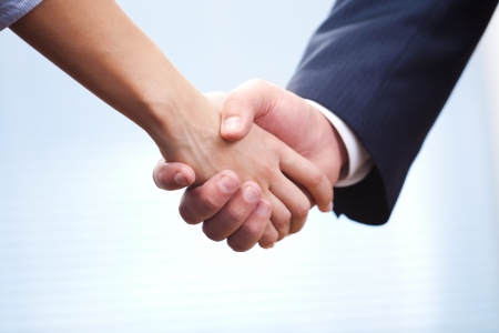 People at work  man and woman hand shaking at a meeting Stock Photo - 16432847