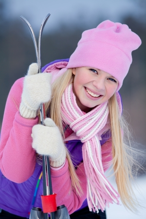 respite: Portrait of blondy young woman with ski in winter time Stock Photo