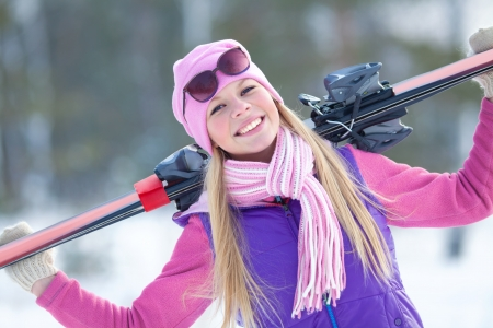 blondy: Portrait of blondy young woman with ski in winter time Stock Photo