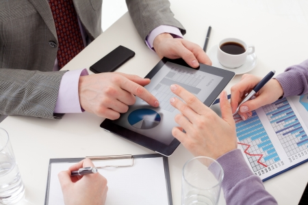 financial occupation: Unrecognizable business colleagues working together and using a digital tablet Stock Photo